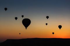 Silhouettes of balloon over sunrise in Cappadocia, Turkye Stock Images