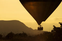 Silhouettes of balloon over sunrise in Cappadocia, Turkye Royalty Free Stock Images