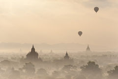 Silhouettes of balloons and temples at Bagan Kingdom, Myanmar (Burma). Royalty Free Stock Photography