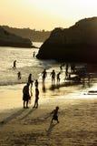 Silhouettes on the beach. At dusk stock photos