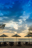 Silhouettes of beach umbrellas sunset and sky Royalty Free Stock Image