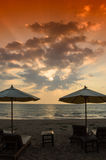 Silhouettes of beach umbrellas sunset and sky Stock Images