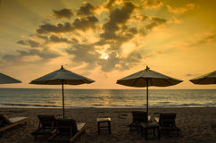 Silhouettes of beach umbrellas sunset and sky Stock Photo