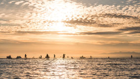 Silhouettes of beautiful couple with sup serf. Silhouettes with sup surfing and paddle on the sea of Japan Royalty Free Stock Photography