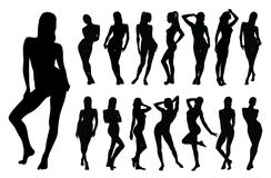 Silhouettes of beautiful sexy girl. Set of black  silhouettes of standing woman in different poses Royalty Free Stock Photos
