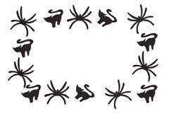 Silhouettes of black cats and spiders carved out of black paper are isolated on white Royalty Free Stock Photography