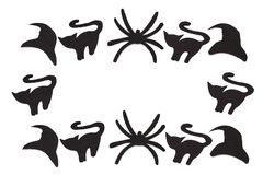 Silhouettes of black cats and spiders and hats carved out of black paper are isolated on white Stock Image