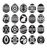 Silhouettes of black easter eggs isolated on white background. Holiday Easter Eggs decorated with flowers, rabbit, leafs. Easter. Holidays. Print design, label vector illustration