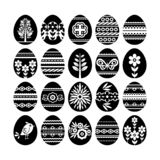Silhouettes of black easter eggs isolated on white background. Holiday Easter Eggs decorated with flowers and leafs. Print design. Label, sticker, scrap royalty free illustration