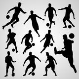 Silhouettes black soccer players Royalty Free Stock Image