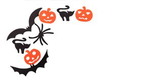 Silhouettes of black volatile bats, cats, orange pumpkins, cats and spider carved out of black paper are isolated on Royalty Free Stock Image