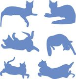 Silhouettes of blue cats. Silhouettes of cats in different poses blue, clip, icon Stock Photos