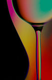 Silhouettes of bottle and wine glass. Elegant silhouettes of a wine bottle and glass with abstract colorful background royalty free stock images