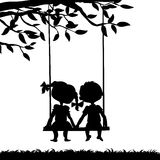 Silhouettes of boy and girl Stock Photos