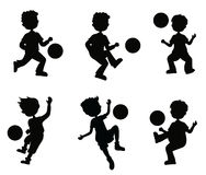 Silhouettes boy playing ball Royalty Free Stock Images