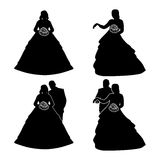 Silhouettes of the bride and groom with a bouquet, isolated on white. Stock Photography