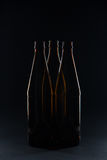 Silhouettes brown glass bottles for beer on a black background Stock Images