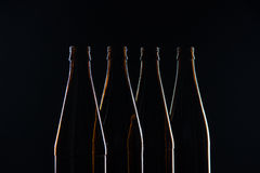 Silhouettes brown glass bottles for beer on a black background Royalty Free Stock Image