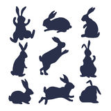9 silhouettes of bunnies. In black and white style made in vector Royalty Free Stock Photography