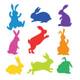9 silhouettes of bunnies. In rainbow colors made in vector Stock Image