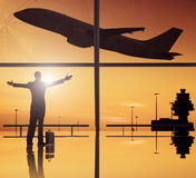 Silhouettes Of Business And Airplane In Airport Royalty Free Stock Photos