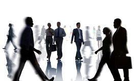 Silhouettes of Business and Casual People Walking Royalty Free Stock Image