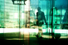 Silhouettes in the business district Royalty Free Stock Photo