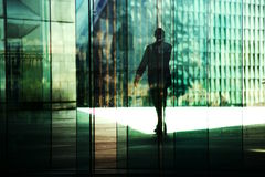 Silhouettes in the business district Stock Photos