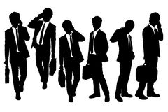 Silhouettes of Business men speaking phone Royalty Free Stock Photos