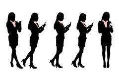 Silhouettes of Business men Walking and speaking mobile phone Stock Photo
