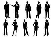 Silhouettes of business men and women Stock Photo