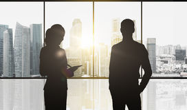 Silhouettes of business partners over city office Royalty Free Stock Photo