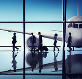 Silhouettes of Business People in the Airport Stock Photography