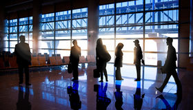 Silhouettes of Business People in Airport Stock Photography