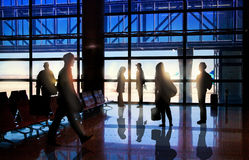 Silhouettes of Business People in Airport Stock Photo