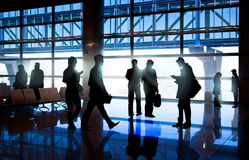 Silhouettes of Business People in Airport Stock Photos