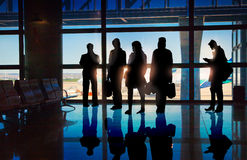 Silhouettes of Business People in Airport Royalty Free Stock Photography