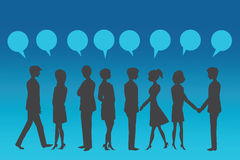 Silhouettes of Business People with blue speech bubble. Royalty Free Stock Photos