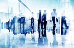 Silhouettes of Business People in Blurred Motion Walking royalty free stock image