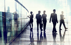 Silhouettes of Business People in Blurred Motion Walking royalty free stock images