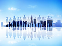 Silhouettes of Business People on a City Scape Looking Up Stock Image