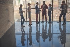 Silhouettes of business people in conference room stock photos