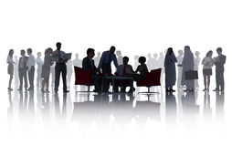 Silhouettes of Business People with Different Activities Stock Photo