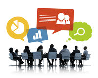 Silhouettes of Business People Discussing Business issues Royalty Free Stock Photography