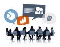 Silhouettes of Business People Discussing Business Issues Royalty Free Stock Images