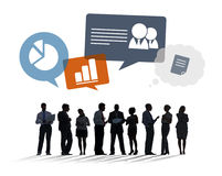 Silhouettes of Business People Discussing Business Issues Royalty Free Stock Photos