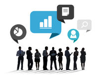 Silhouettes of Business People Discussing Business Issues Stock Photography