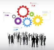 Silhouettes of Business People Discussing and Multicolored Gears. With global networking themed symbols royalty free illustration
