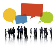 Silhouettes of Business People Discussing with Speech bubble Stock Photography