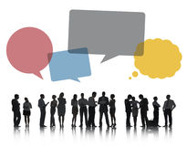 Silhouettes of Business People Discussing with Speech Bubbles Stock Photos